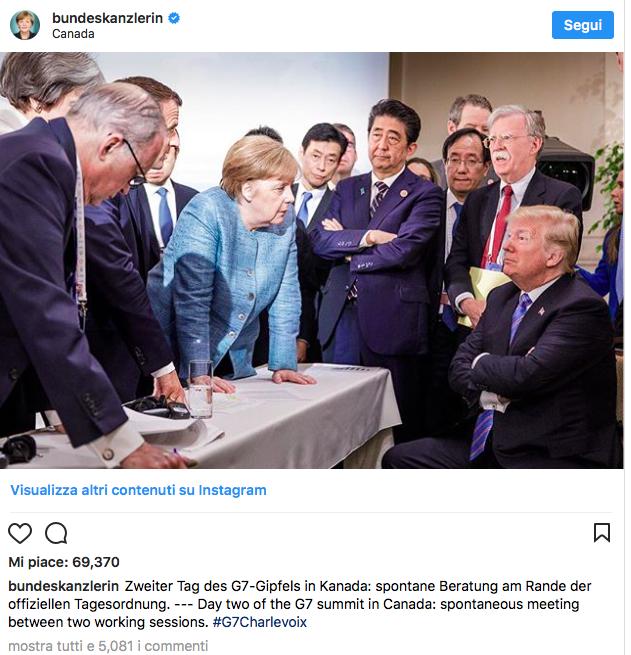Merkel Trump G7 foto linguaggio del corpo
